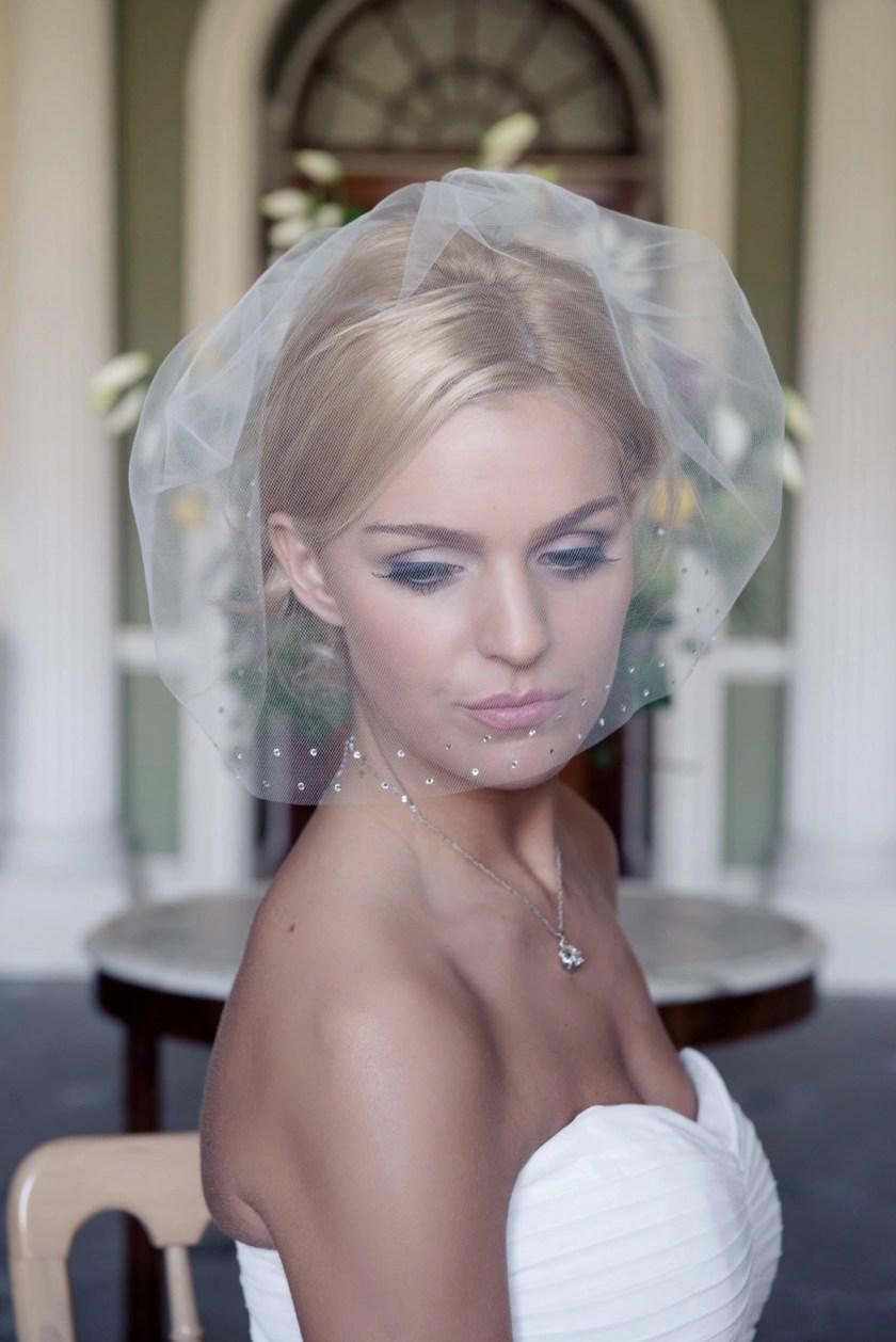 Bride wearing tulle and diamante birdcage veil