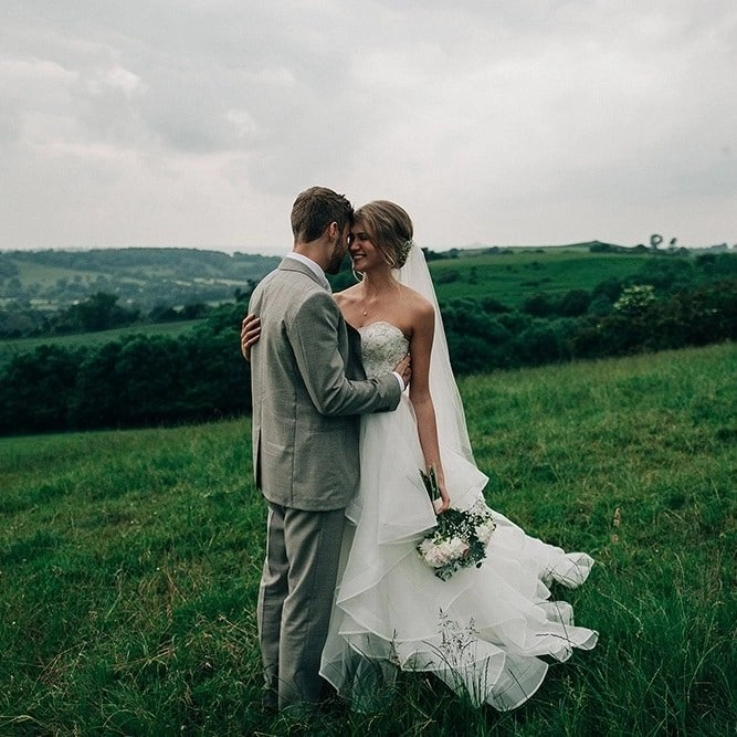 Two tier fingertip length scalloped edge veil on real bride Taisy