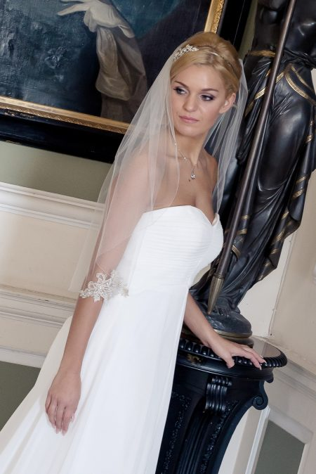 Xenobia – single layer waist length veil with a silver lace appliques