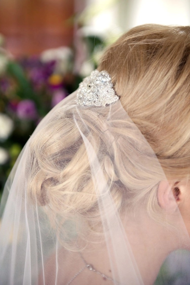 Close up of pretty lace detail on top of wedding veil