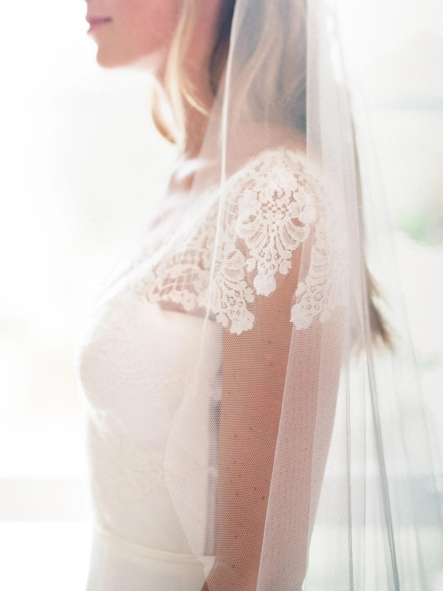Close up shot of barely there veil on real bride Olivia