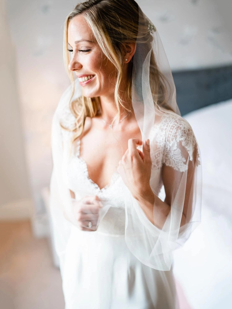 Pretty image of barely there veil on real bride Olivia