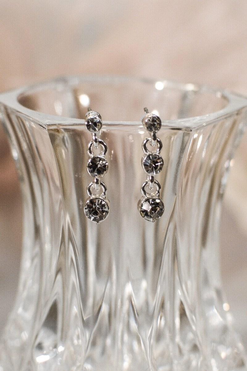 tls1537 earrings on glass