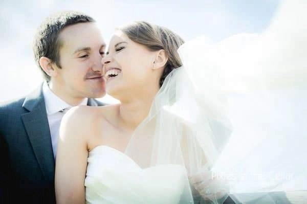 laughing bride wearing veil