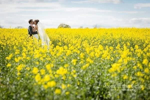 happy couple in yello flowers