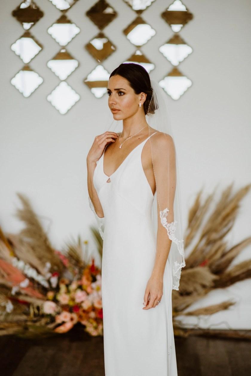 Alana - single layer hip length veil with silver & ivory lace & a hand beaded edge