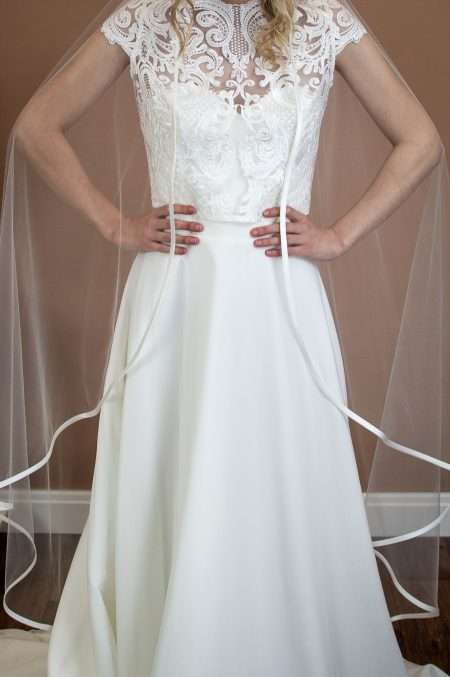 Camilla - single layer waltz length angel cut veil with satin edging front view closeup