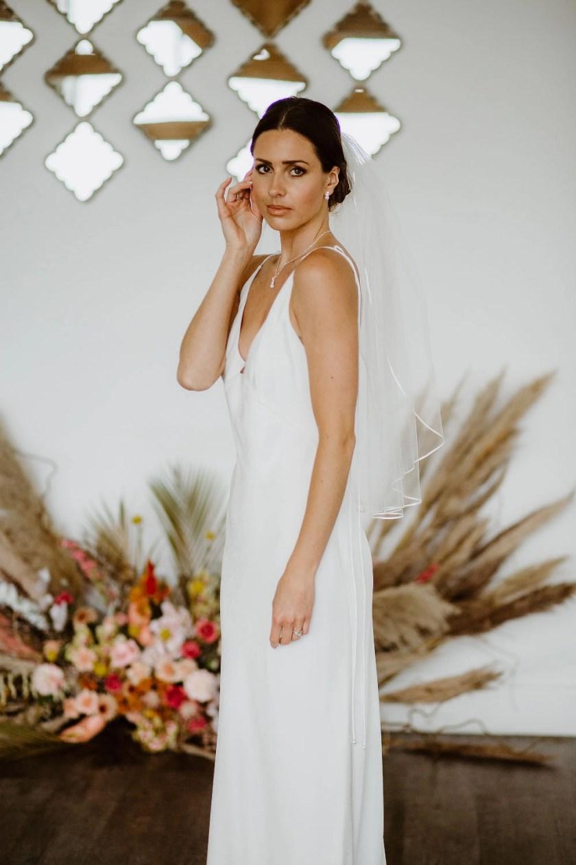 Daisy – one layer waist length veil with a pretty narrow ribbon trim