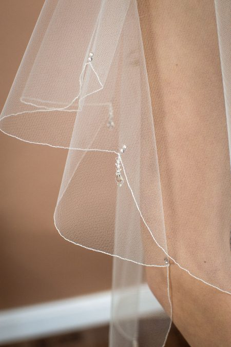 Danika - two layer waist length wedding veil with a scalloped edge and teardrop crystals closeup