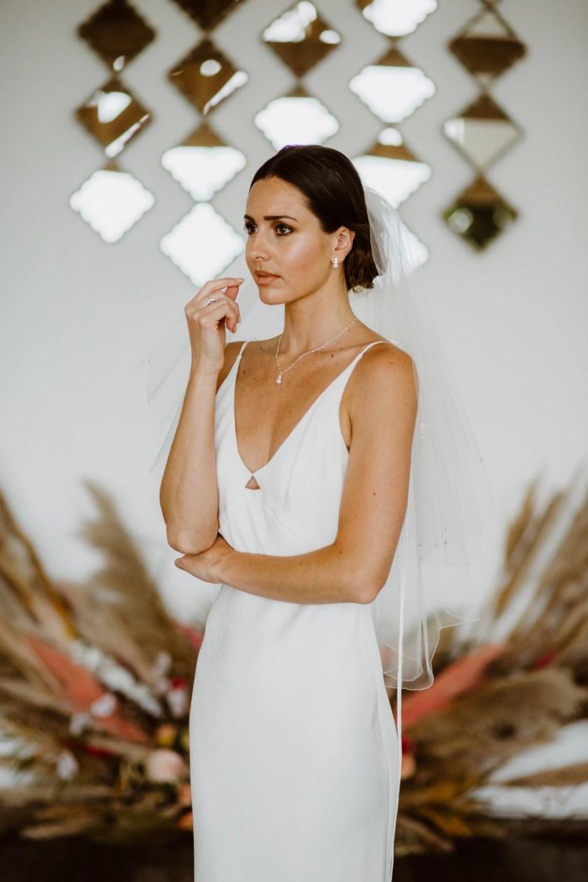 Danika - two layer waist length wedding veil with a scalloped edge & teardrop crystals