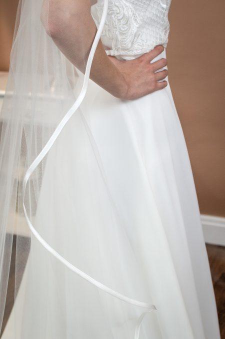 Freya - one layer chapel length waterfall cut veil with a satin binding edge closeup