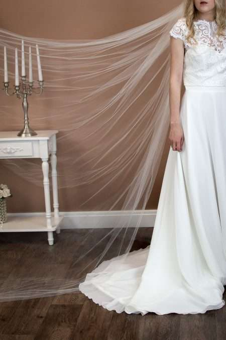 Jessica - one layer cathedral length extra wide plain veil on a bride closeup front view