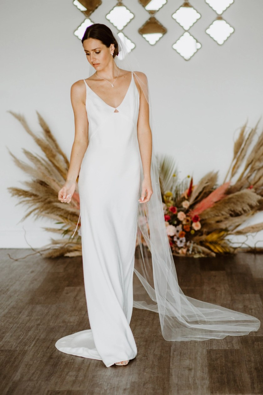Lola - one layer chapel length veil with a pearl and diamante design