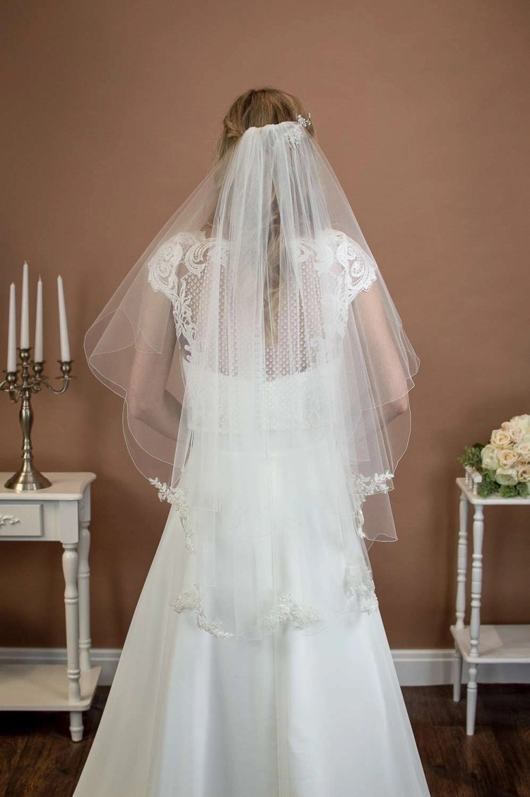 Maisie - short two layer scalloped edge veil with beaded lace appliques on a bride