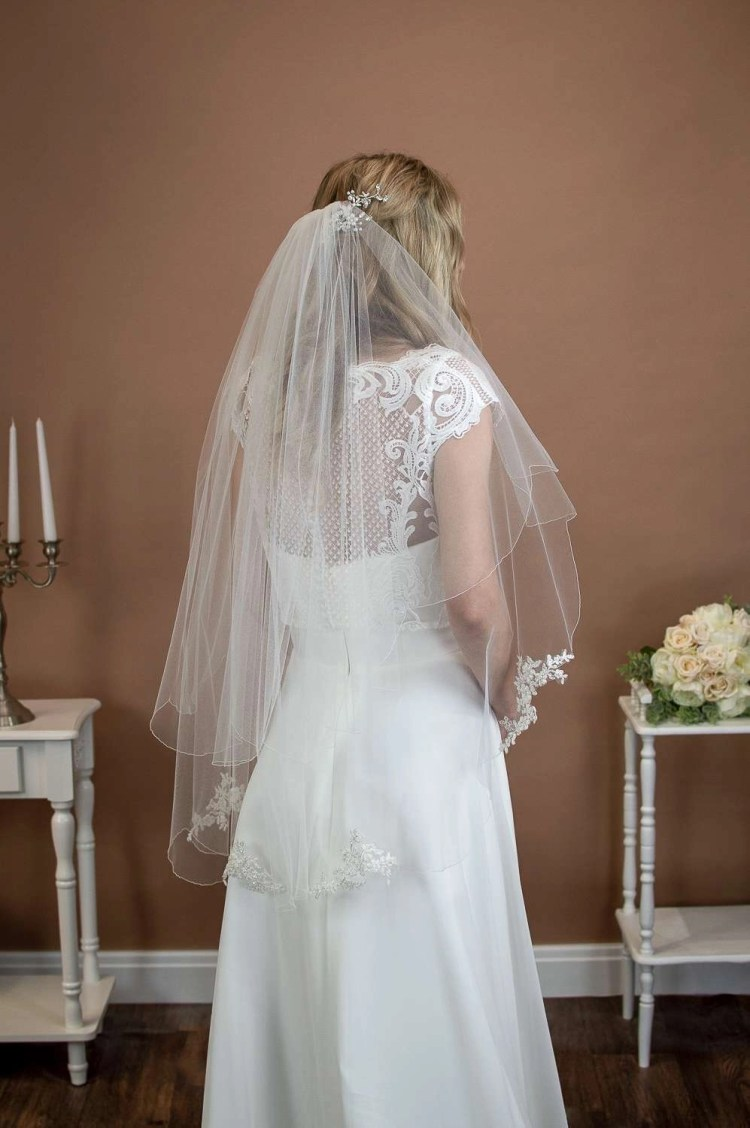 Maisie - two layer scalloped edge veil with beaded lace appliques on a bride