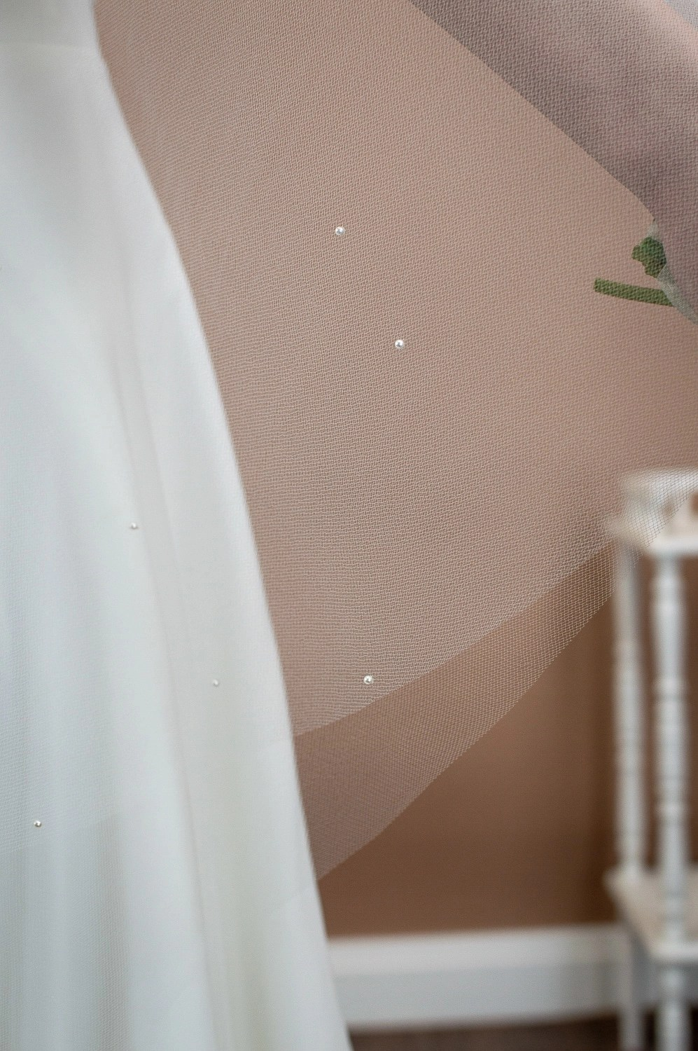 Matilda - two tier hip length drop veil with a cut edge and scattered pearls closeup