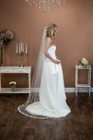 Meadow - long single layer floor length veil with 3D flower edging on bride