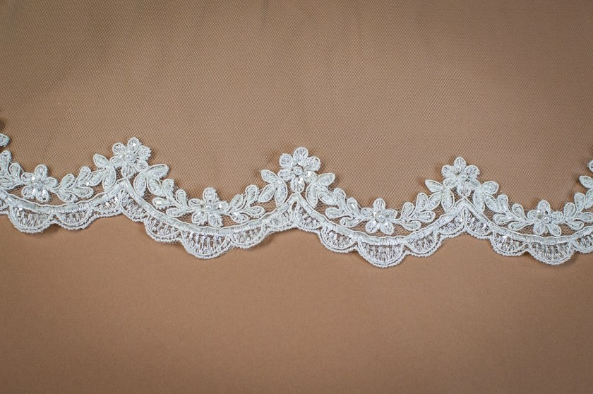 Paris - one tier chapel length veil with beaded scalloped lace edging closeup on solid background (3)