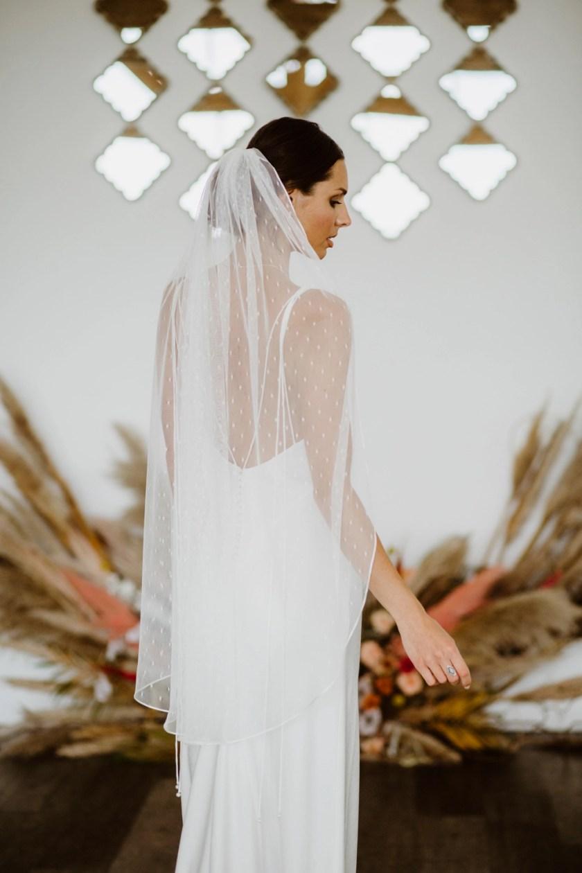 Poppy - fingertip length single layer ribbon edge veil in dotty tulle