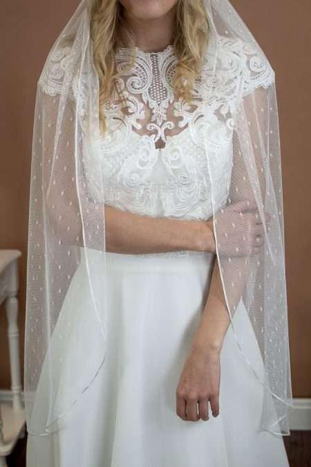 Poppy - fingertip length single layer ribbon edge veil in spotty dotty tulle front view closeup