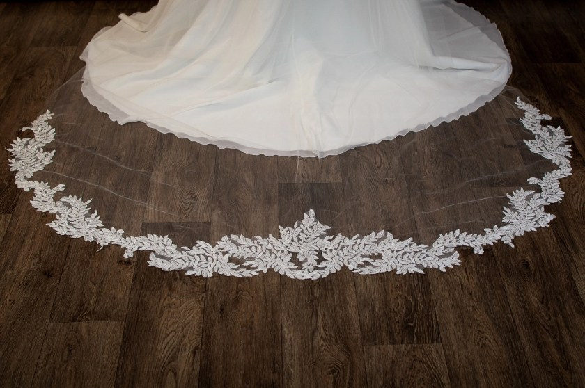 Scarlett - one layer cathedral veil with sequined lace appliques around the bottom closeup detail