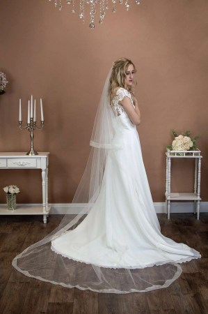 Summer - long two tier chapel length veil with a wide sheer ribbon edge on a bride alt