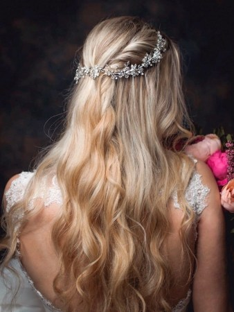 Neptune - crystal & diamante hair vine with floral accents on a model bride TLH3076sil