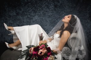 Bride wearing French lace wedding veil on chaise elegant brunette tamsin