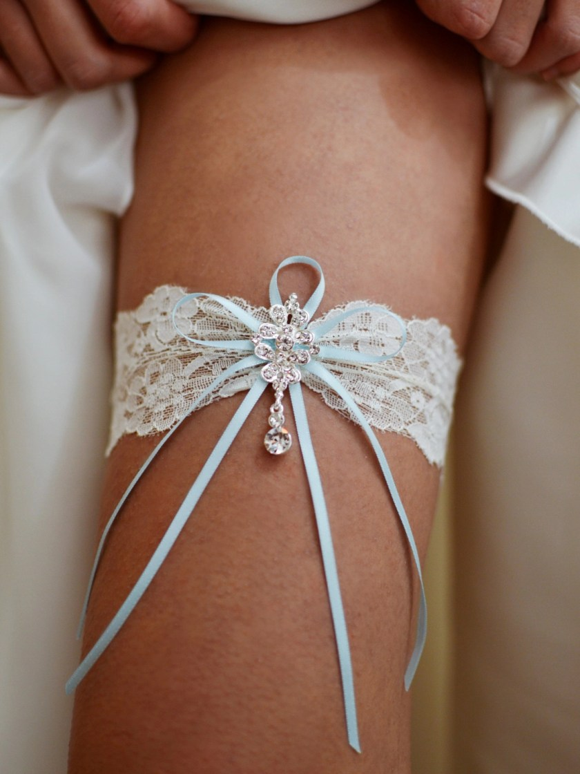 Gorgeous flat lace bridal garter with crystal drop on leg TLG515