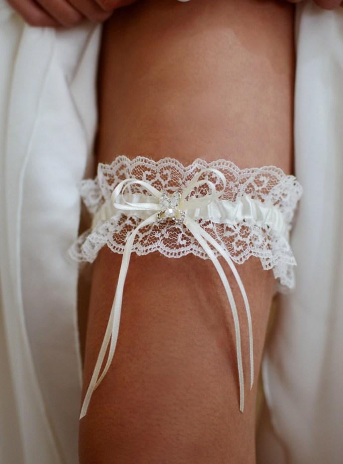 Pretty wedding garter with crystal detailing on leg TLG512