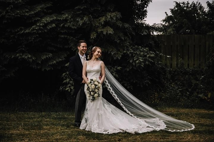 Stunning bride Natalie wears our gorgeous chapel length Paris veil