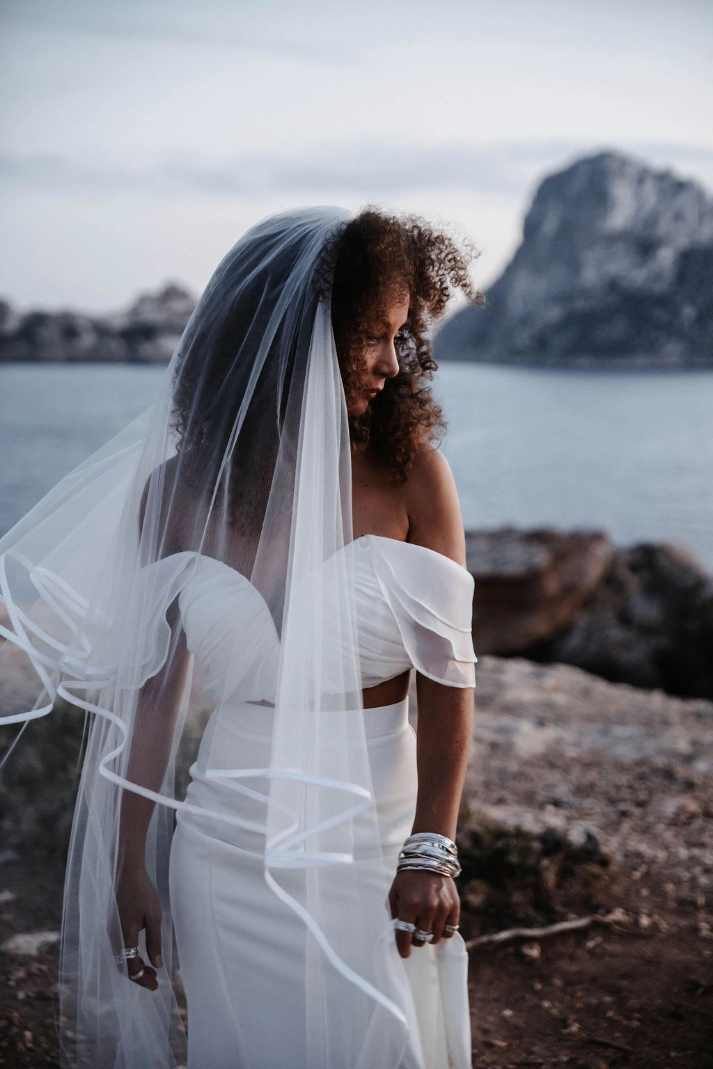 Ibiza at Sunset Black bride with hair down with veil long chapel satin edge (26)