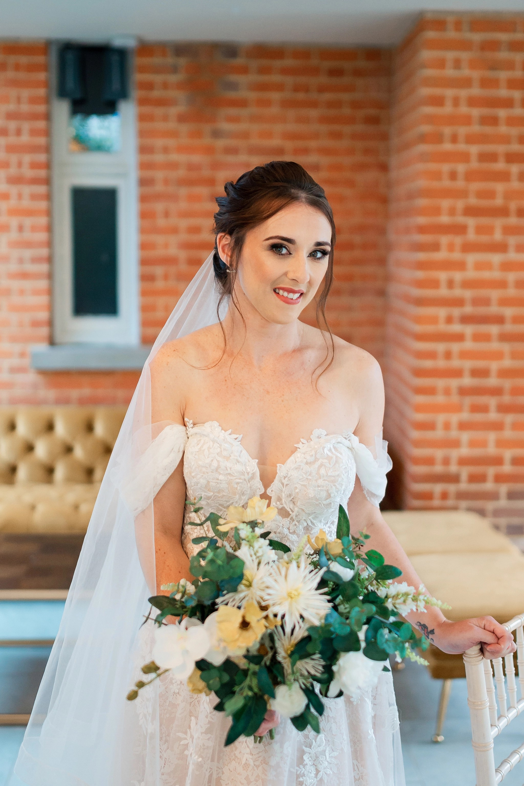 Beautiful Bride in a bardot dress and long veil