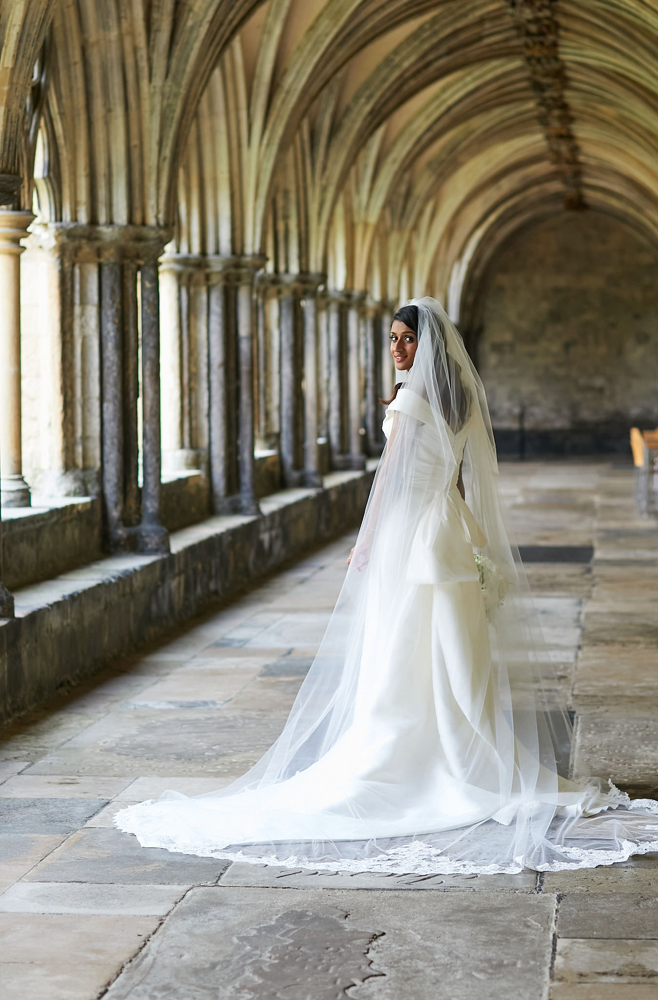 Bride Derrina in cathedral veil at Norwich cathedral