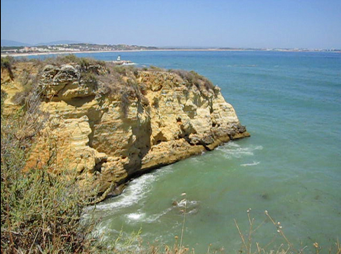 7 places to visit in Portugal - Algarve - Located in the west Algarve, Lagos is a seaside city with beautiful beaches, sandstone cliffs and fun cafes and bars. You can dive, snorkel, kayak or just relax on sandy beaches.