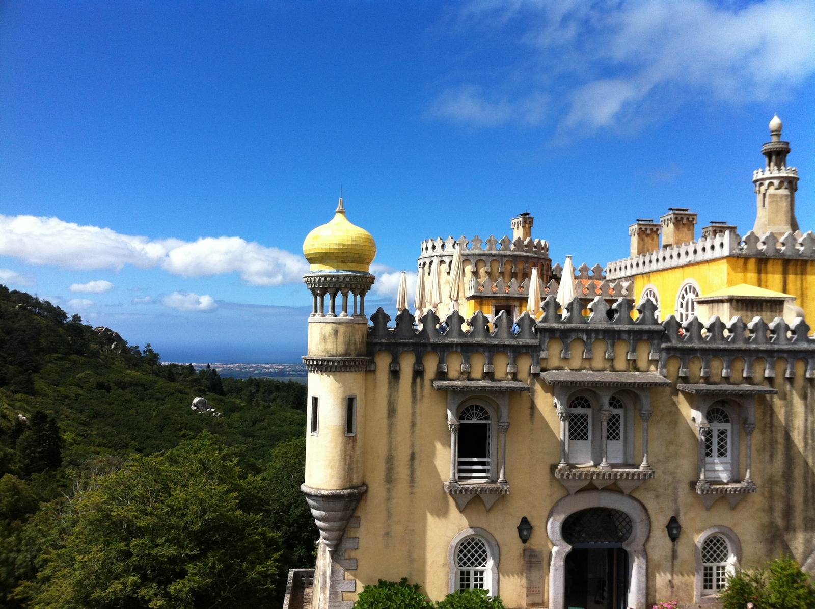 7 places to visit in Portugal - Sintra - The Pena Palace at Sintra looks like something out of a fairytale with fanciful turrets and bright yellow paint. Be sure to check out the extensive gardens as well.