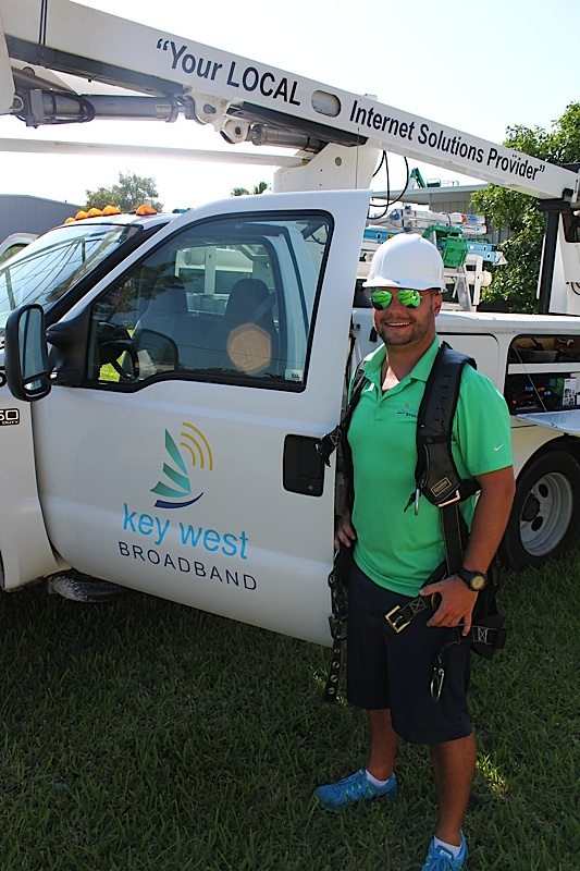 Key West Broadband's Jordan Smith handles it all — riding in a bucket truck, installing the cables, handling accounts as an IT guy, renting space on towers and even climbing them.