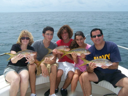 The Conti family from Jupiter, who stayed at Tranquility Bay Resort, had a blast yellowtailing with Capt. Chris Johnson. Despite a visit from an 8-foot lemon shark, they put a nice bunch of 'tails in the cooler and enjoyed them for lunch back at RumBums at the 7 Mile Marina. Of course, 12 year old Taylor caught the most and the largest fish!