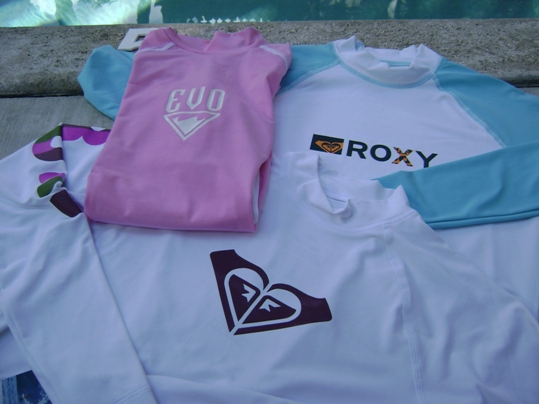 Rash guards by Roxy & Evo keep divers protected from the sun and in the water when it's too warm for a wet suit
