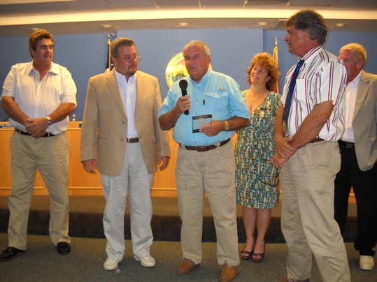 "Walter McDowell, center, accepted a commemorative plaque for his years of service as the Public Works Director from the Marathon City Council Tuesday evening. Pictured (l-r) are Pete Worthington, Mayor Mike Cinque, Ginger Snead, Vice Mayor Don Vasil and Dick Ramsay. ""I've already retired once from DOT, and I hope this time it's for good,"" McDowell laughed."