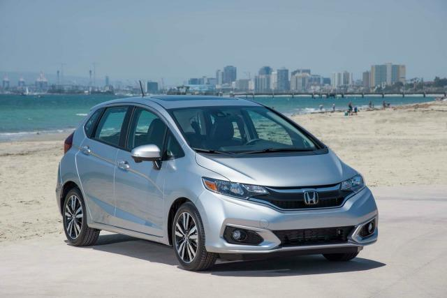 """Two questions with similar themes percolate throughout the auto industry. Consumers want to know the best car for the money and the best car money can buy. The answers are subjective. But the first question is more relevant to more buyers, and so here's one vote for the 2018 Honda Fit. Now in its third generation and 11th year since replacing the Honda Civic hatchback, the Fit is a five-door subcompact with more interior room than its appearance indicates. Versatile, well-constructed inside and outside and value-priced, the little engine that can is arguably the best new car available in the United States for less than $20,000. The 2018 Fit is available in LX, Sport, EX and EX-L trims. All Fits have 1.5-liter, four-cylinder engines with front-wheel drive. A standard six-speed manual or optional continuously variable transmission (CVT) is available except on EX-L trim. It only has a CVT. With a manual transmission, the engine is rated at 130 horsepower. The new Sport trim (my test vehicle) has a 7-inch touchscreen interface that connects with Apple CarPlay and Android Auto and a six-speaker sound system. A few new styling extras include 16-inch alloy wheels, foglights and a leather-wrapped steering wheel and shift knob. Also new for 2018 is an upgraded suspension and improved safety features. The Fit's interior space is impressive, including ample legroom in the back seat. Like many vehicles with manufacturer's claims of five-passenger seating, the Fit is more appropriate for four adults. The second-row seating called """"Magic Seat"""" is innovative. The 60/40-split rear bench folds flat into the floor, and the seat bottoms prop up to provide upright space for tall objects. With both rear seatbacks folded down, the Fit has 52.7 cubic feet of cargo room, not too much less than some smaller crossovers and the best in its segment. With the Fit's front passenger seat folded flat, items nearly eight-feet long will fit. The Honda Fit shouldn't be expected to break land speed re"""