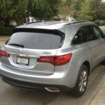 The 2016 Acura MDX has a power lift tailgate and three rows of seating.