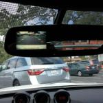 The 2014 Nissan 370Z features a rear detection system in the rear view mirror.