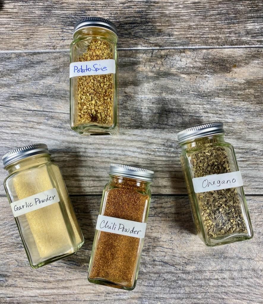 Create a potato spice blend with chili powder, garlic powder and oregano
