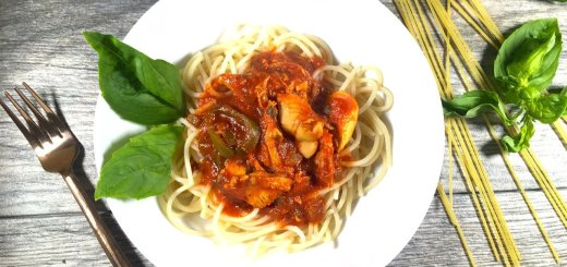 spicy chicken spaghetti made with red sauce and jalapeños