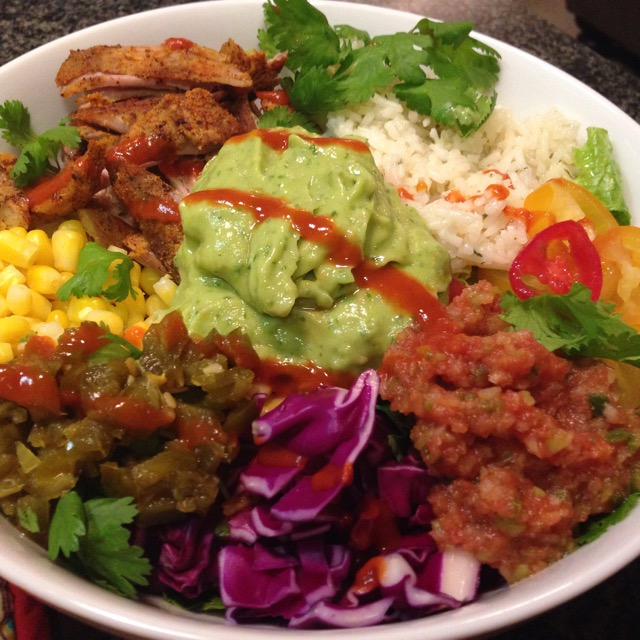 carnitas burrito bowls with avocado salsa verde