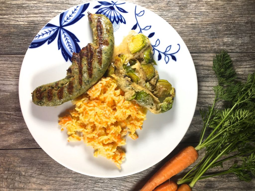 sweet carrot rice, Parmesan Brussels sprouts, chicken chorizo verde sausages