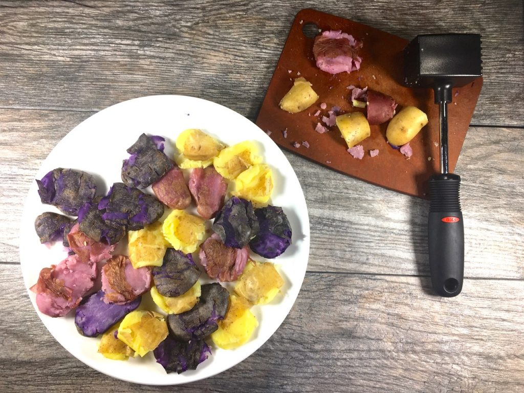 Boiled fingerling potatoes, cut up and then smashed with a meat tenderizer
