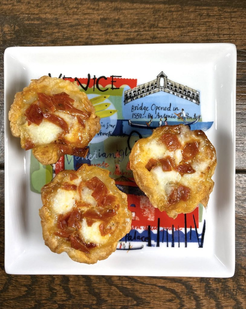 Gluten-Free Pepperoni Pizza Bites made with turkey pepperoni, pizza sauce, buffalo mozzarella and Schär puff pastry dough.