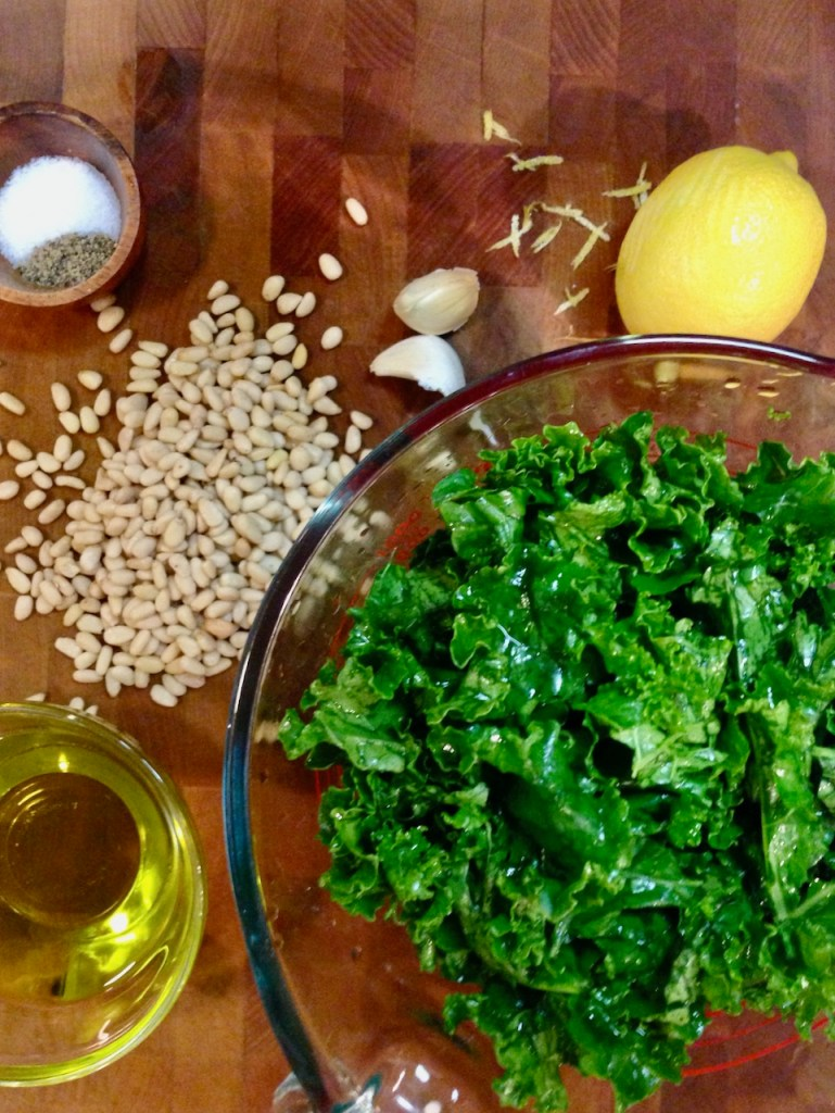 ingredients to make a kale pesto without cheese using lemon zest, garlic, and pine nuts